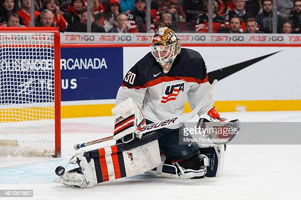 Thatcher Demko of Team United States makes a pad save in a preliminary round game during the 2015 IIHF World Junior Hockey Championships against Team...