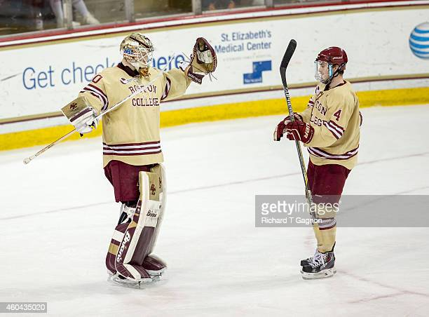 Thatcher Demko of the Boston College Eagles celebrates a victory with teammate Teddy Doherty after NCAA hockey against the Michigan Wolverines at...