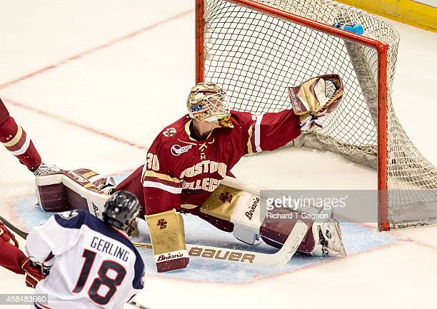 Thatcher Demko of the Boston College Eagles makes a glove save against Trevor Gerling of the Connecticut Huskies during NCAA hockey at the XL Center...