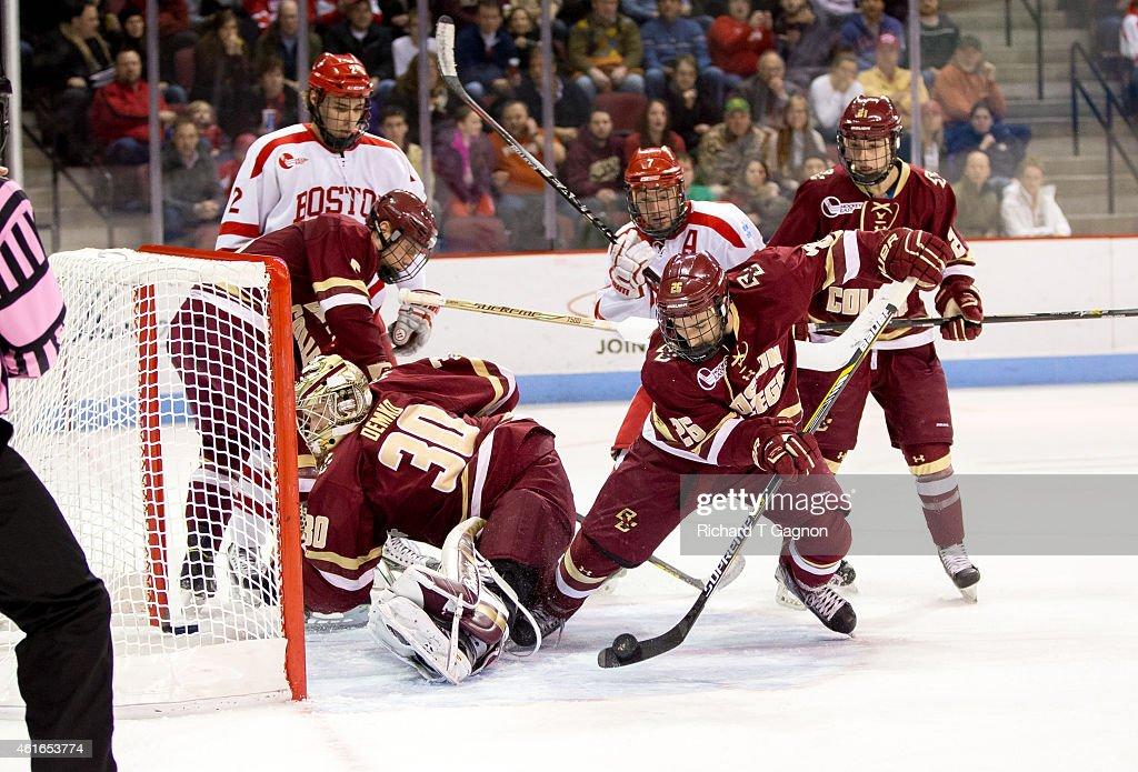 Thatcher Demko #30 of the Boston College Eagles makes a save while facing into the net while teammates Austin Cangelosi #26, Matthew Gaudreau #21and Michael Matheson 35 battle for the puck against Ahti Oksanen #2 and Cason Hohmann #7 both of the Boston University Terriers during NCAA hockey at Agganis Arena on January 16, 2015 in Boston, Massachusetts.