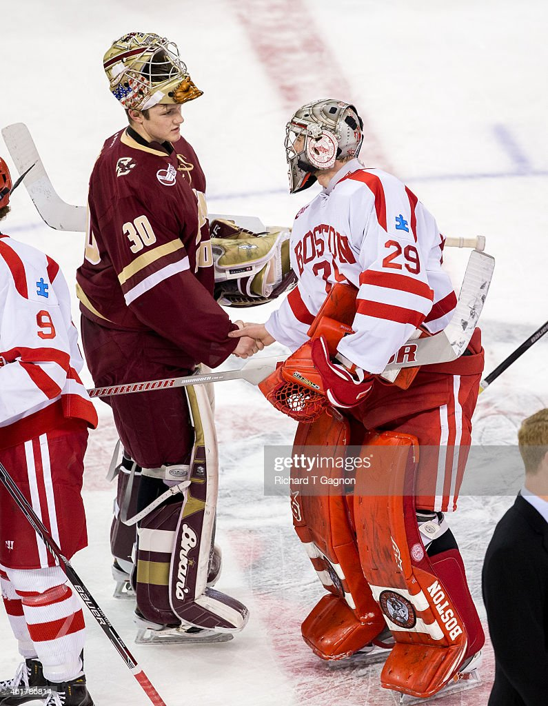 Thatcher Demko #30 of the Boston College Eagles shakes hands with Matt O'Connor #29 of the Boston University Terriers after NCAA hockey at Agganis Arena on January 16, 2015 in Boston, Massachusetts. The Eagles won 4-2.