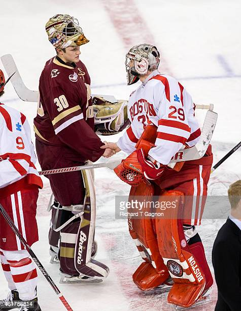 Thatcher Demko of the Boston College Eagles shakes hands with Matt O'Connor of the Boston University Terriers after NCAA hockey at Agganis Arena on...