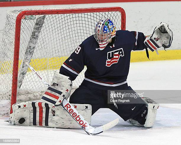 Thatcher Demko of the USA makes a toe save against Sweden during the U-18 Four Nations Cup on November 9, 2012 at the Ann Arbor Ice Cube in Ann...