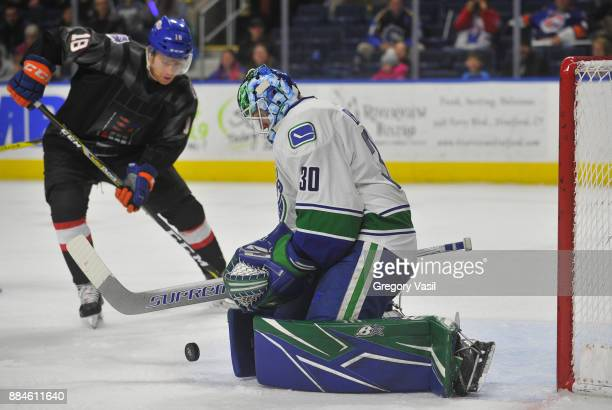 Thatcher Demko of the Utica Comets makes a save during a game against the Bridgeport Sound Tigers at the Webster Bank Arena on December 2 2017 in...