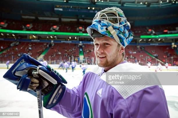 Thatcher Demko of the Vancouver Canucks stands by the bench before their NHL game against the Detroit Red Wings at Rogers Arena November 6 2017 in...
