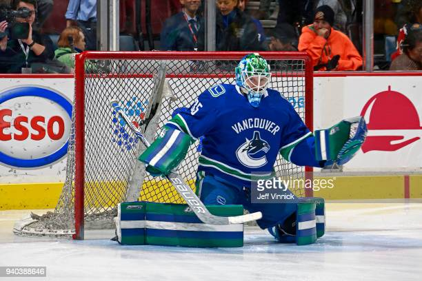 Thatcher Demko of the Vancouver Canucks warms up before his first NHL game against the Columbus Blue Jackets at Rogers Arena March 31 2018 in...