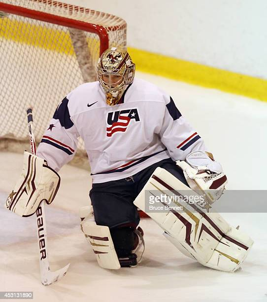 Thatcher Demko of USA White skates against Team Sweden during the 2014 USA Hockey Junior Evaluation Camp at the Lake Placid Olympic Center on August...