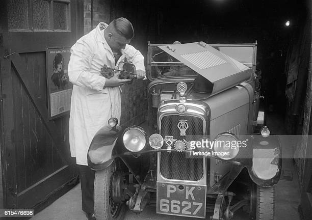 FA Thatcher working on his 1929 Triumph Super Seven Triumph Super Seven 1929 832 cc Vehicle Reg No PK6627 Thatcher FA Artist Bill Brunell