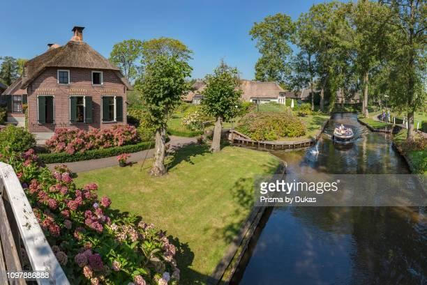 Thathed roof houses along a canal, Giethoorn, Overijssel