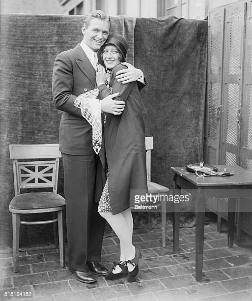 That's my papa. New York. Joan Crawford, she of the movies and her new husband Douglas Fairbanks Jr., he also of the movies as they appeared cuddlin'...