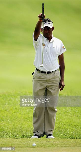 Thaworn Wiratchant of Thailand lines up a putt on the 10th green during the first round of the Maybank Malaysian Open 2006 at Kuala Lumpur Golf and...