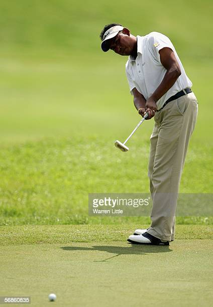 Thaworn Wiratchant of Thailand putts on the 10th green during the first round of the Maybank Malaysian Open 2006 at Kuala Lumpur Golf and Country...