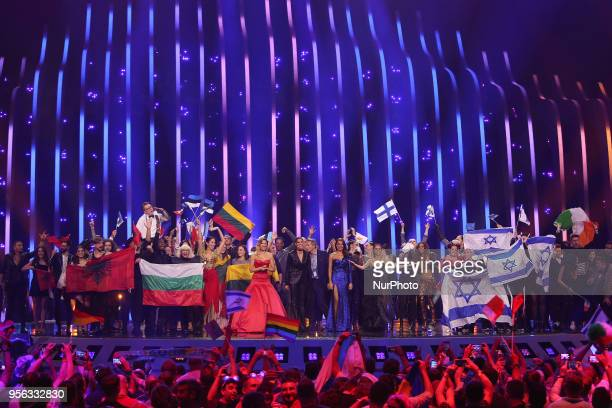 The 10 artists who qualify to the Final celebrate on stage during the first semifinal of the 2018 Eurovision Song Contest at the Altice Arena in...