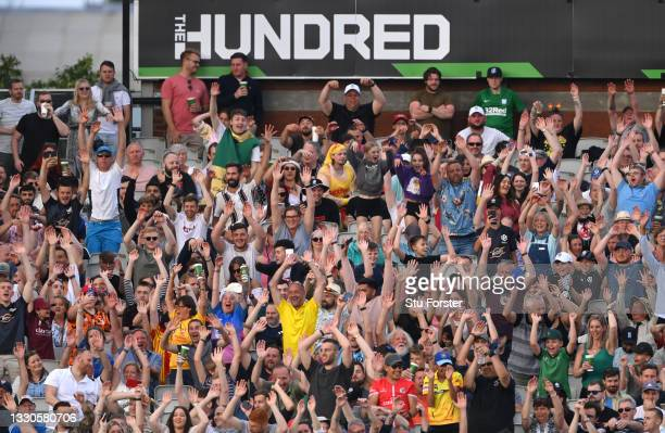 The 100 crowd partake in a mexican wave during the Hundred match between Manchester Originals and Birmingham Phoenix at Emirates Old Trafford on July...