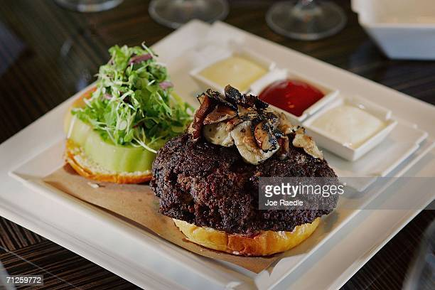 The $100 tribeefburger sits in a bun at the Old Homestead Steakhouse located in the Boca Raton Resort and Club June 21 2006 in Boca Raton Florida The...