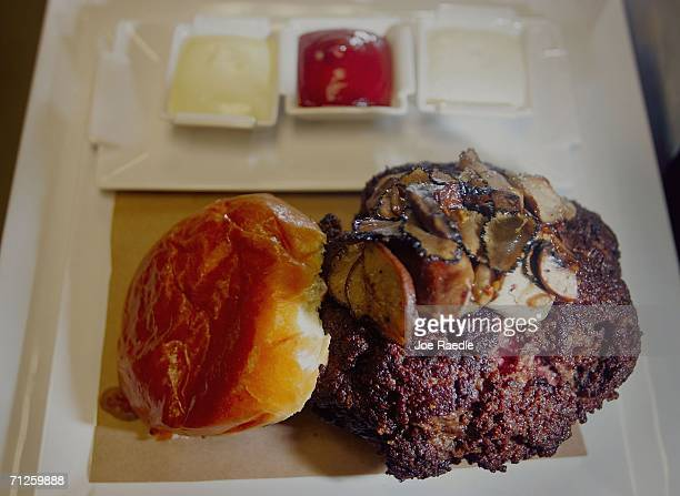 The $100 tribeefburger sits on a bun at the Old Homestead Steakhouse located in the Boca Raton Resort and Club June 21 2006 in Boca Raton Florida The...