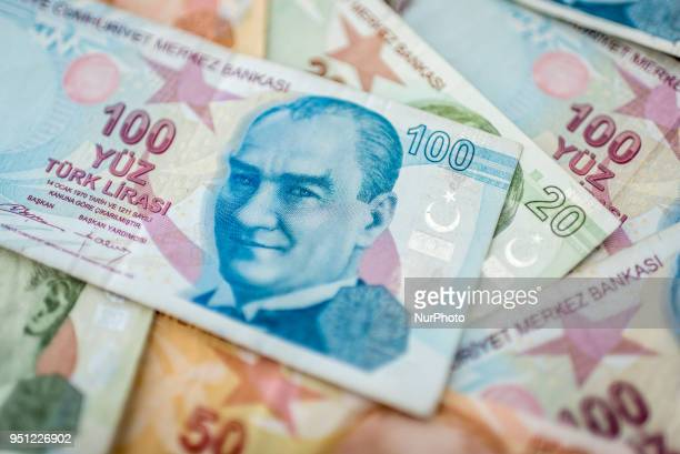 The 100 Turkish Lira banknote with the face of Turkey's founder Mustafa Kemal Ataturk on top of 5 20 and 50 Turkish Lira bills. The lira has been a...