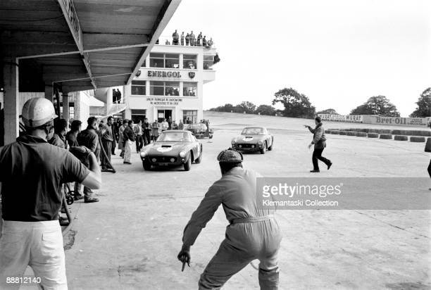 The 1000 km of Paris Montlhery Septmber 9 1961 Two Ferrari 250GTs enter the pits