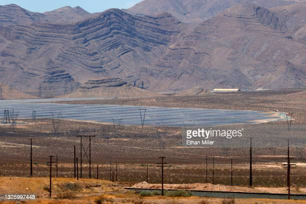 The 100-megawatt MGM Resorts Mega Solar Array is shown after launch behind transmission towers on June 28, 2021 in Dry Lake Valley, Nevada. The...
