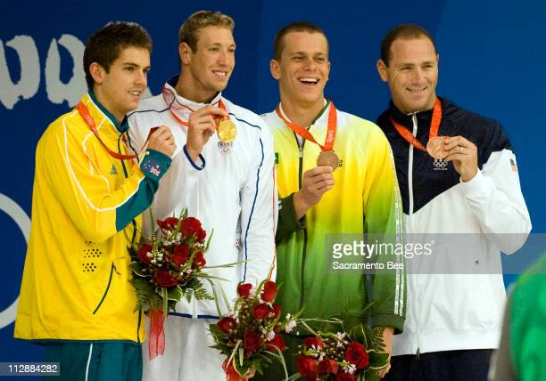 The 100meter freestyle winners stand on the medal stand on Thursday August 14 in the Games of the XXIX Olympiad in Beijing China From left are silver...