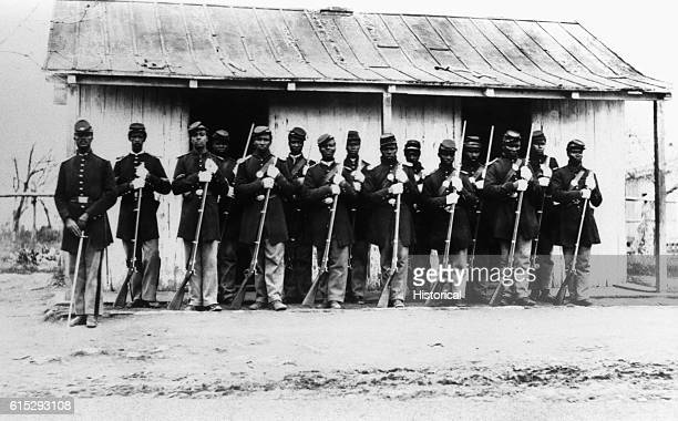 The 107th U.S. Colored Infantry stand guard during the United States Civil War, ca. 1860-1865.