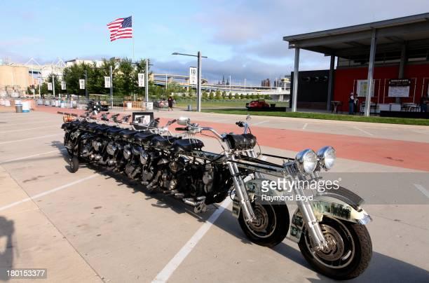 The 10passenger Timeline Motorcycle built by Steve 'Doc' Hopkins sits outside the HarleyDavidson Museum to commemorate the HarleyDavidson 110th Year...