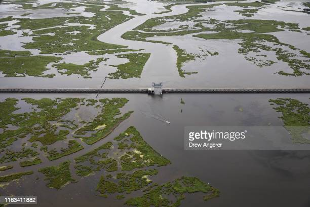 The $1.1 billion Lake Borgne Surge Barrier stands near the confluence of and across the Gulf Intracoastal Waterway and the Mississippi River Gulf...
