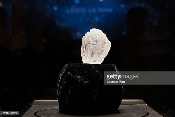 The 1109carat rough Lesedi La Rona diamond the biggest rough diamond discovered in more than a century sits in a display case at Sotheby's on May 4...