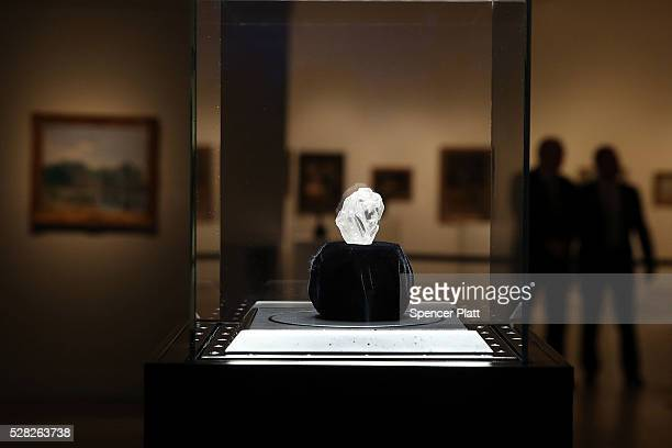The 1109-carat rough Lesedi La Rona diamond, the biggest rough diamond discovered in more than a century, sits in a display case at Sotheby's on May...