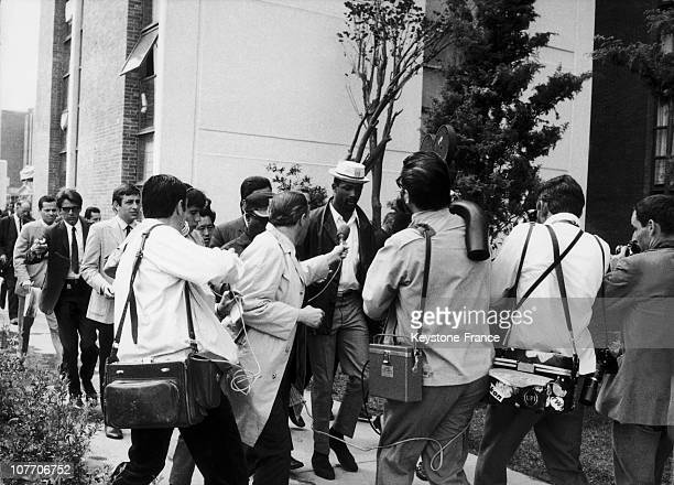 The 110Meter Champion Evicted From The Olympic Village After Greeting With His FellowCountryman Tommie Smith With A Fist Wearing A Black Glove As...
