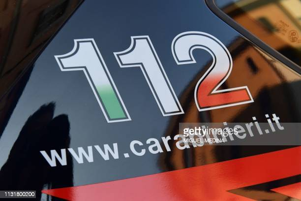 The 112 telephone number for emergency services is pictured on a car of the Italian Carabinieri police on March 21 2019 in Crema east of Milan