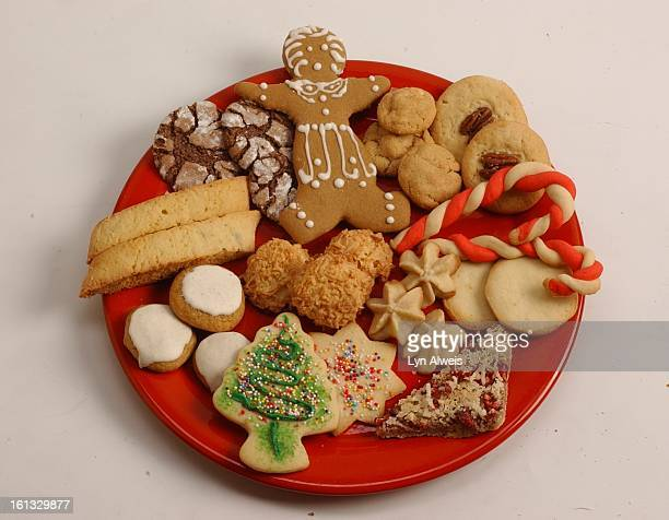 'The 12 Cookies Of Christmas' top row Chocolate Crinkles Gingerbread Person Peanut Butter Bites Danish Sugar Cookie middle row Betty's Biscotti...