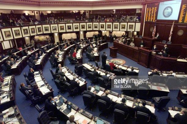 The 120 members of the Florida State House of Representatives attend a special session 12 December 2000 aimed at drafting a resolution that would go...