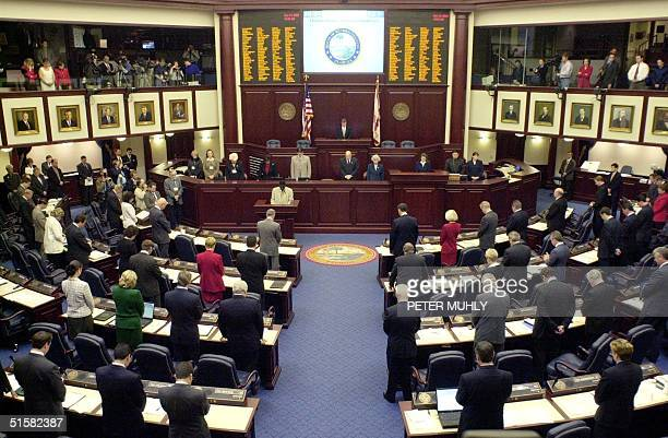 The 120 members of the Florida State House of Representatives bow their heads in prayer prior to the beginning of a special session 12 December 2000...