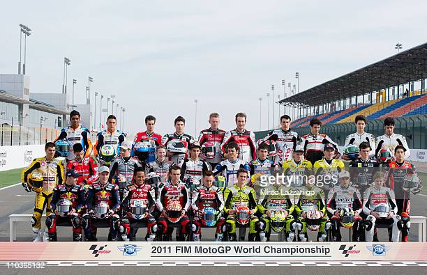 The 125 cc riders pose on the starting grid before the free practice of Doha GP at Losail Circuit on March 17, 2011 in Doha, Qatar.