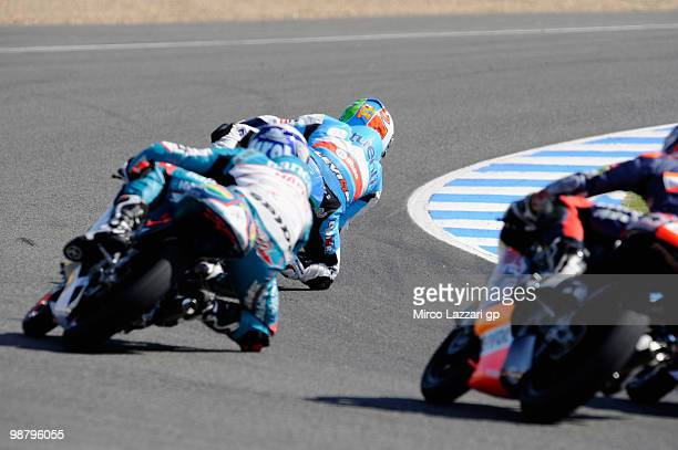 The 125 cc riders round the first corner of the first lap during the 125 cc race at Circuito de Jerez on May 2 2010 in Jerez de la Frontera Spain