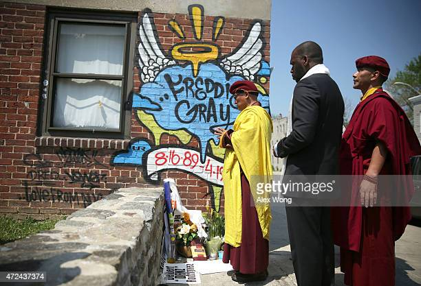 The 12th Gyalwang Drukpa the Buddhist leader of South Asia says a prayer at the spot where Freddie Gray was arrested May 7 2015 in Baltimore Maryland...