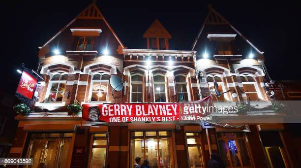 The 12th man pub by Anfield shows a banner showing RIP Gerry Blayney before the UEFA Champions League group E match between Liverpool FC and NK...