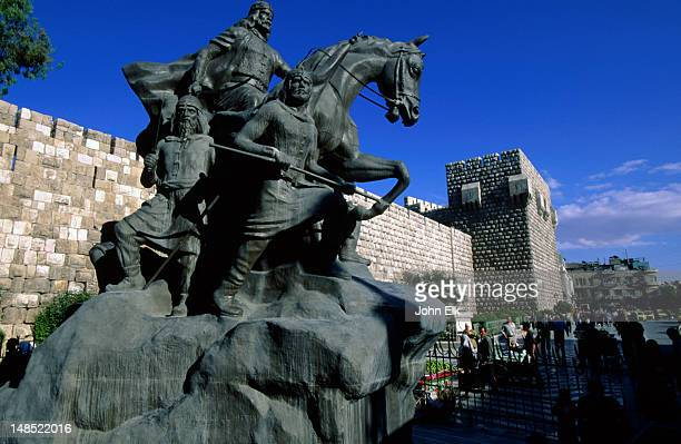 The 13th century walls of the Old City citadel in Damascus and statue of Sala ud-Din.