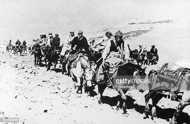 The 14th Dalai Lama flees from Tibet to India across the Himalayas following a failed uprising against the Chinese occupation 1959 He is riding a...