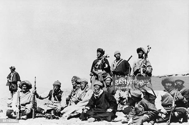 The 14th Dalai Lama flees from Tibet to India across the Himalayas following a failed uprising against the Chinese occupation 1959 Here he sits with...