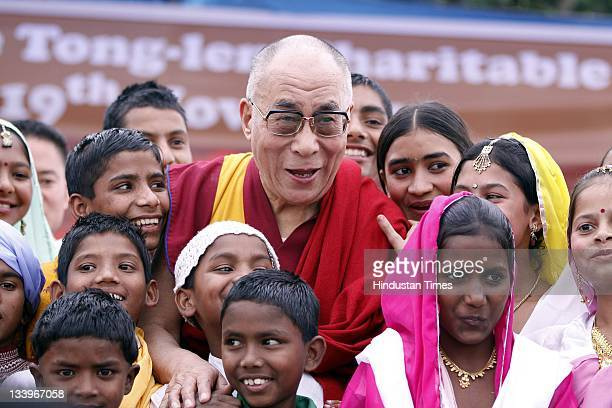 The 14th Dalai Lama with slums' children during the inauguration function of Tonglen charitable Trust on November 19 2011 at Sarah near Dharamsala...