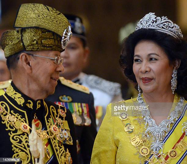 The 14th King of Malaysia King Abdul Halim Mu'adzam Shah shares a light moments with Queen Hamidah Hamidun after the coronation at the new National...