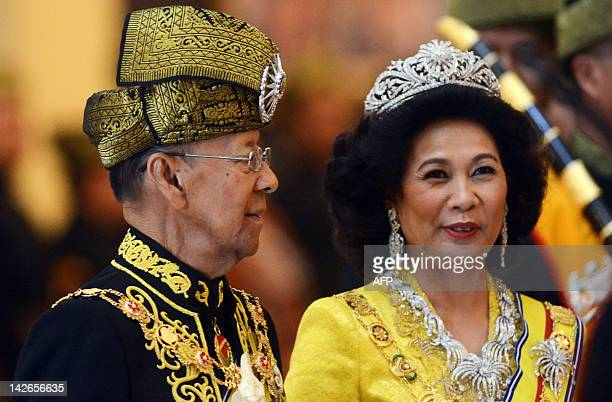 The 14th King of Malaysia King Abdul Halim Mu'adzam Shah sharse a light moments with Queen Hamidah Hamidun after the coronation at the new National...