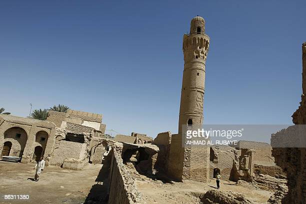 KRAUSS The 14thcentury brick minaret of the Dhu alKifl mosque tilts outside the entrance to the Jewish shrine of Ezekiel the prophet who followed the...