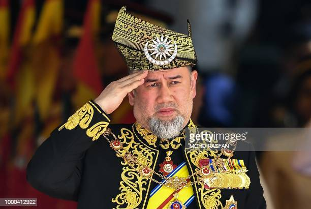 The 15th king of Malaysia Sultan Muhammad V salutes the royal guard of honour during the opening ceremony of the parliament in Kuala Lumpur on July...