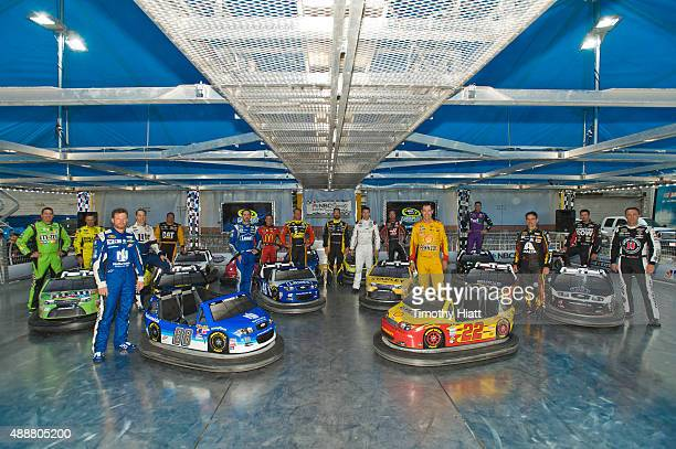 The 16 Chase Grid challengers pose with replica bumper cars at NBC Sports' Bumper NASCAR Tour at Chase Fest in Downtown Chicago on September 17 2015...