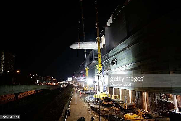 The 16 tonne fuselage section of a British Airways branded Airbus A319 is lifted over 100ft by crane into KidZania London on October 4 2014 in London...