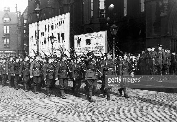 The 16th Manchesters march past Lord Kitchener at Manchester Town Hall with the rest of the City Battalion
