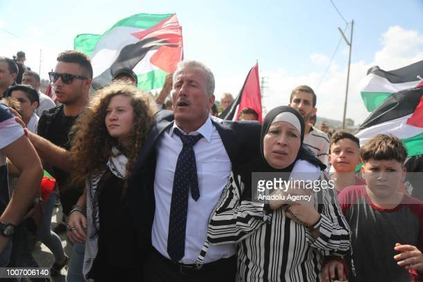 The 16yearold Palestinian Ahed alTamimi who was awarded the 'Hanzala Award for Courage' in Turkey is released with her mother Nariman Tamimi after 7...